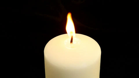 A white candle is blown out Footage