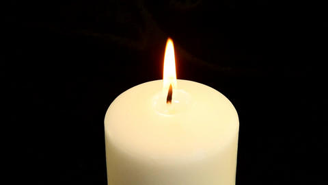 A white candle is blown out Stock Video Footage
