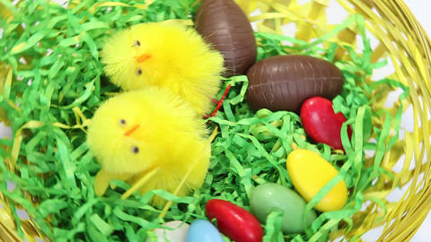 Spinning easter nest filled with sweets Stock Video Footage