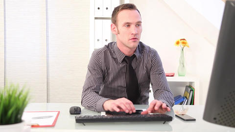 Businessman typing on a keyboard and talking on phone Stock Video Footage