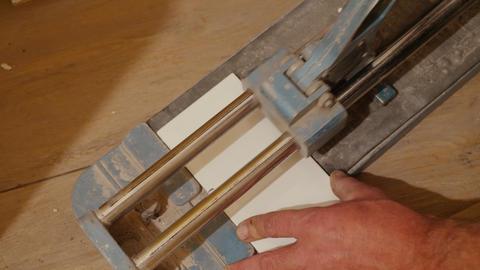 Cutter cuts ceramic tile Live Action