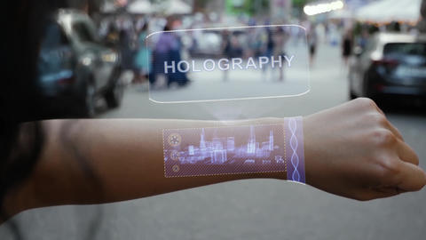Female hand activates hologram Holography Live Action
