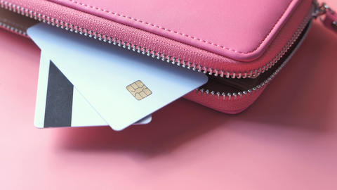 credit cards and wallet on pink background Live Action