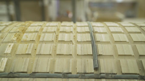 Rounded wooden facade. Manufacture of wooden furniture. A Plant For Live Action