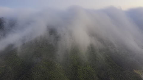 Time lapse scenic cloudfall over green mountains. Hyper lapse clouds landscape Live Action