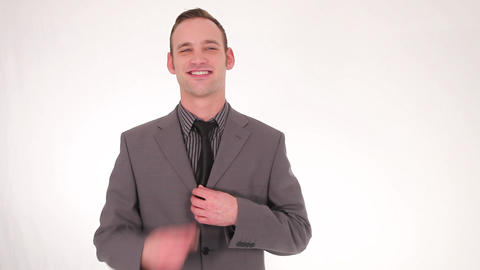 Smiling businessman straightening his tie Stock Video Footage