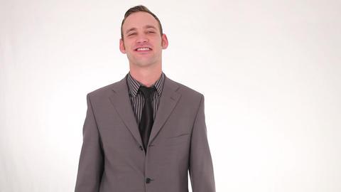 Smiling businessman straightening his tie Stock Video Footage
