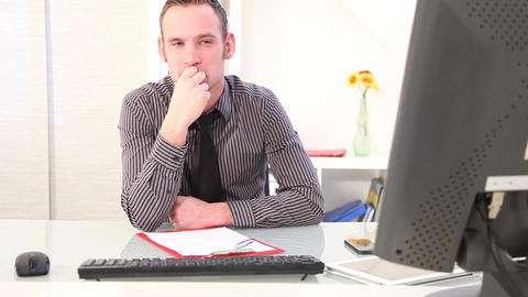 Businessman sits pensively in front of a computer Stock Video Footage