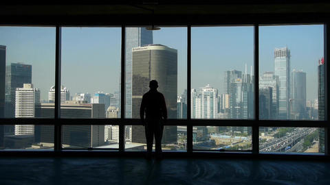 a businessman walking to windows & outlook business... Stock Video Footage