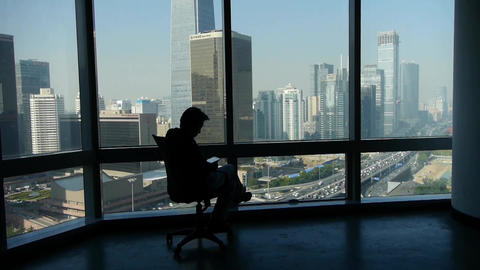 a business human sitting & reading,business building... Stock Video Footage