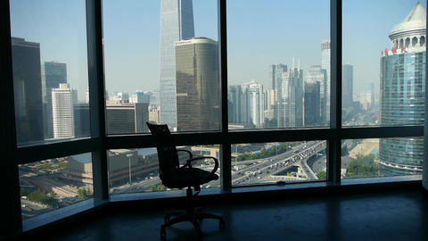 an empty chair against business building from french window Animation
