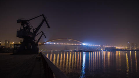 River Traffic At Night By Lupu Bridge And A Large Crank In Shanghai stock footage