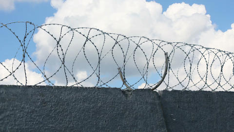 Sky Behind Barbed Wire 1 Stock Video Footage