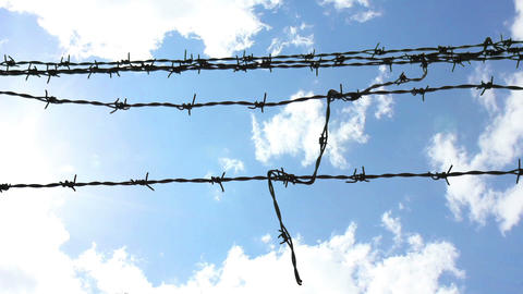 Sky Behind Barbed Wire 3 stock footage