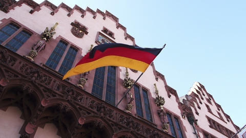 German flag floats in slow motion at the Frankfurt city hall Stock Video Footage
