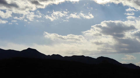 Panoramic of silhouette mountains in autumn,Altocumulus cloud in blue sky Footage