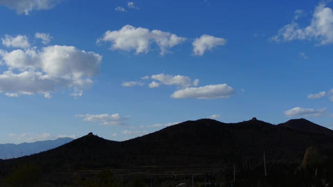 Panoramic of village silhouette mountains in autumn,Altocumulus cloud in blue sk Footage