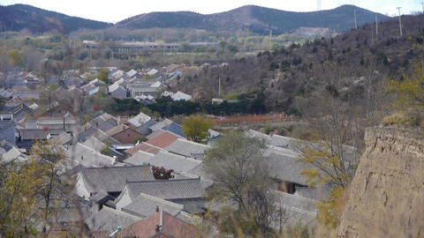 Panoramic of Chinese ancient buildings village & mountains in autumn Footage