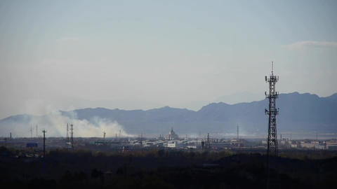 Panoramic of city town & factory smoke relying on... Stock Video Footage