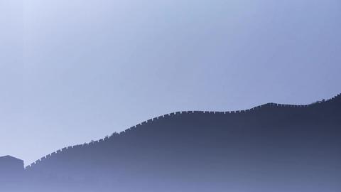 Great Wall on mountain peak hill ridge & Battlements shadow silhouette in mi Footage