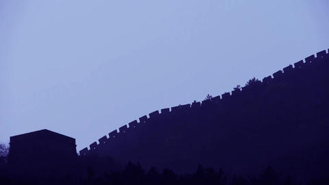 Great Wall on mountain peak hill ridge & Battlements shadow silhouette in mi Footage