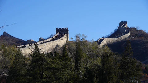 visitor climbing Great Wall on mountain peak,China ancient architecture,fortress Footage