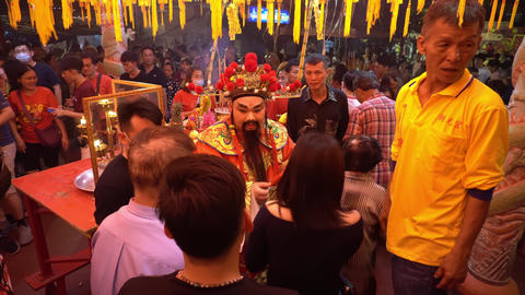 God of wealth distribute red envelope at chinese temple at Chew Jetty Live Action