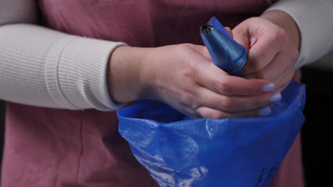 Woman Puts Pastry Nozzle in a Confectionery Bag Live Action