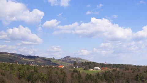 Moving cloudscape above rural landscape, aerial hyper lapse Live Action