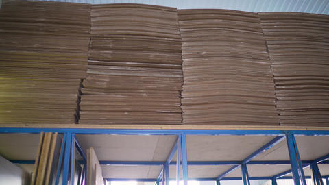 Plywood sheets on the shelves in the factory floor. Sheets in the warehouse for Live Action