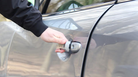 Man opening door of automobile. Hand of male businessman opens and holds the car Live Action