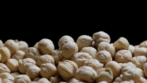 Close up of a bunch of chickpeas on a black background, dry chickpeas abstract background Live Action