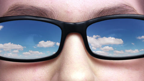 Sky reflected in glasses Stock Video Footage