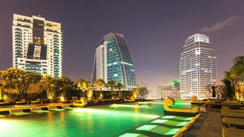 4k - TIMELAPSE OF SWIMMING POOL AT DUSK IN MODERN CITY Stock Video Footage