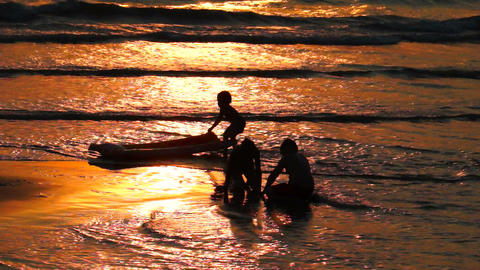 Children Playing on the Beach at Sunset Stock Video Footage