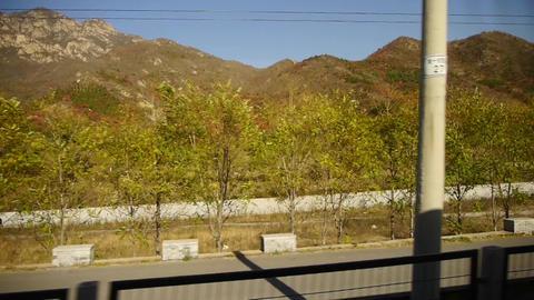 autumn mountain in rural countryside.Speeding train... Stock Video Footage