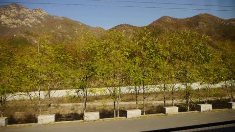 autumn mountain in rural countryside.Speeding train travel,scenery outside windo Footage