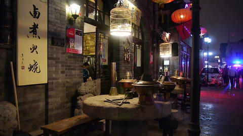 china tradition gourmet,chafing dish on stone mill,beijing alley street Footage