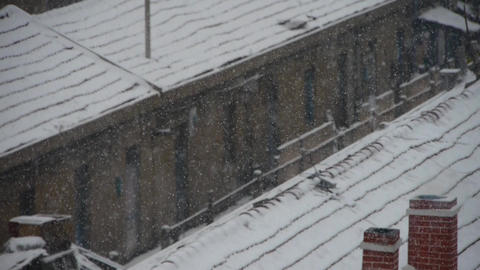 falling snowflake,snow cover house roof Footage