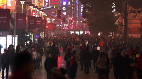 Busy Night Crowds Traffic On Nanjing Road stock footage