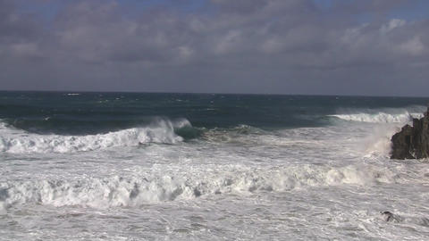 Waves crashing into Cape Byron Stock Video Footage