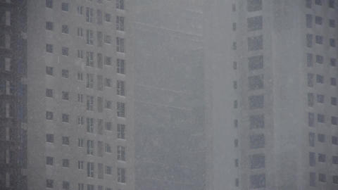 building in snowstorm,snowfall in city Footage