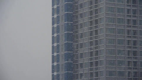 building in snowstorm,snowfall in city Stock Video Footage