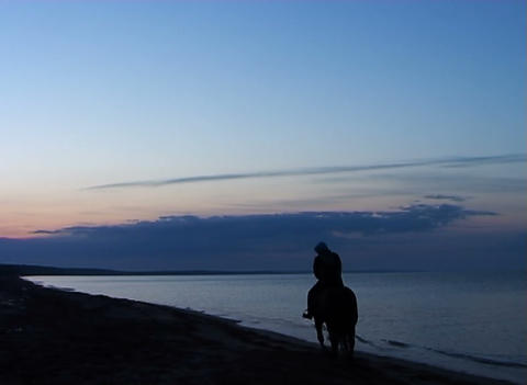 Mysterious Horseman Leaves On Sunrise stock footage