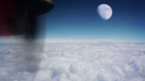 Moon above the clouds Stock Video Footage