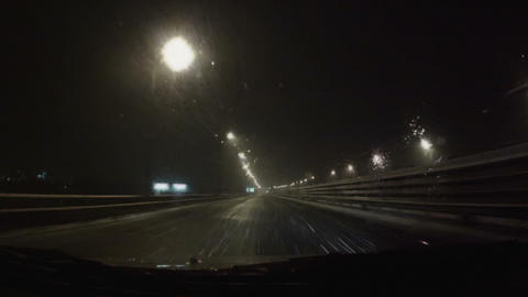 Car Moving On The Night Road Through Snowstorm stock footage