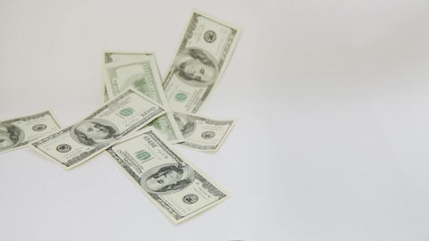 American dollars falling on white background Footage