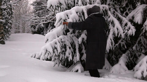 Elderly woman walking in a snow 2 Stock Video Footage