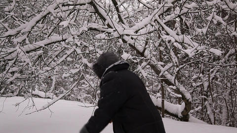 Elderly woman walking in a snow 4 Stock Video Footage