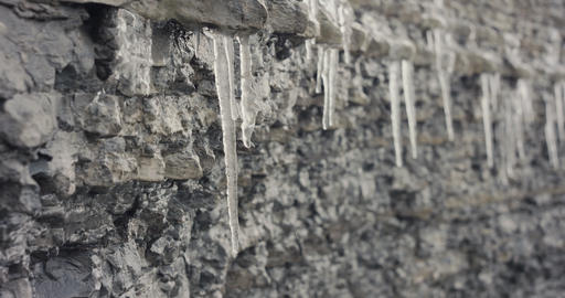 Global warming icicles melting or meltdown cliff close up slow motion Live Action